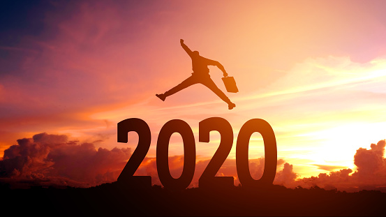 istock Silhouette young Business man happy to 2020 new year success concept. 1158834832