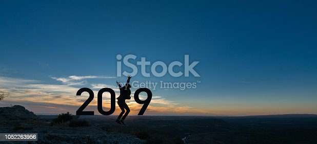 istock A silhouette young business man jumping between 2019 1052263956