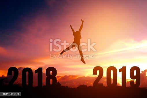 945046208 istock photo Silhouette young man happy to 2019 new year 1021081182