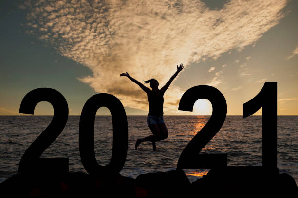 Silhouette young woman happy for 2020 new year stock photo