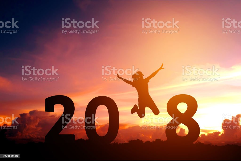 Silhouette young woman jumping to 2018 new year stock photo