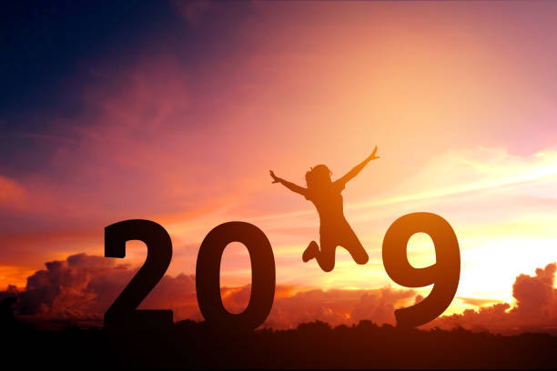 Silhouette young woman jumping to 2019 new year Silhouette young woman jumping to 2019 new year 2019 stock pictures, royalty-free photos & images