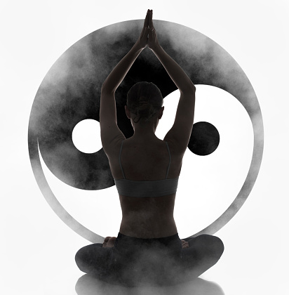 silhouette young woman practicing yoga yin yang symbol at