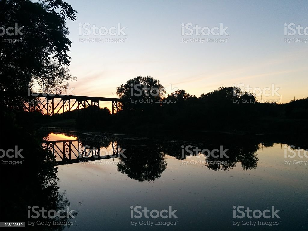 Silhouetted Bridge by Sunset stock photo