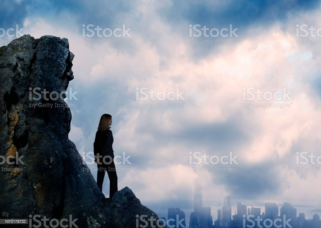 Silhouetted Businesswoman Looking Over City stock photo