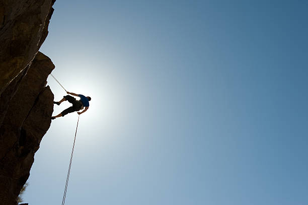 Silhouetted Climber stock photo