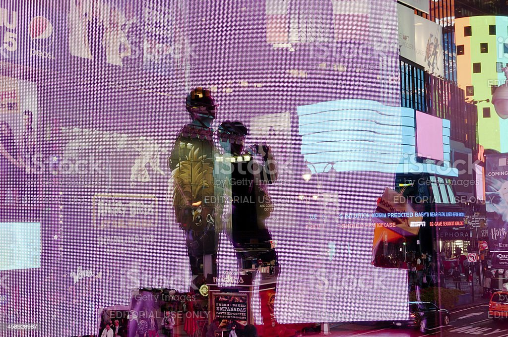 Silhouetted couple takes pictures in Times Square royalty-free stock photo