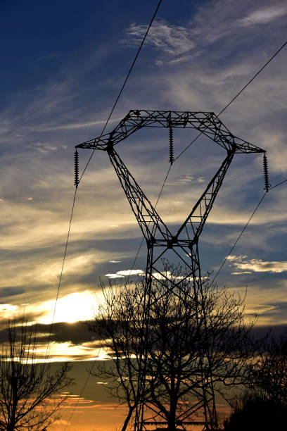 Silhouetted electric pylon stock photo