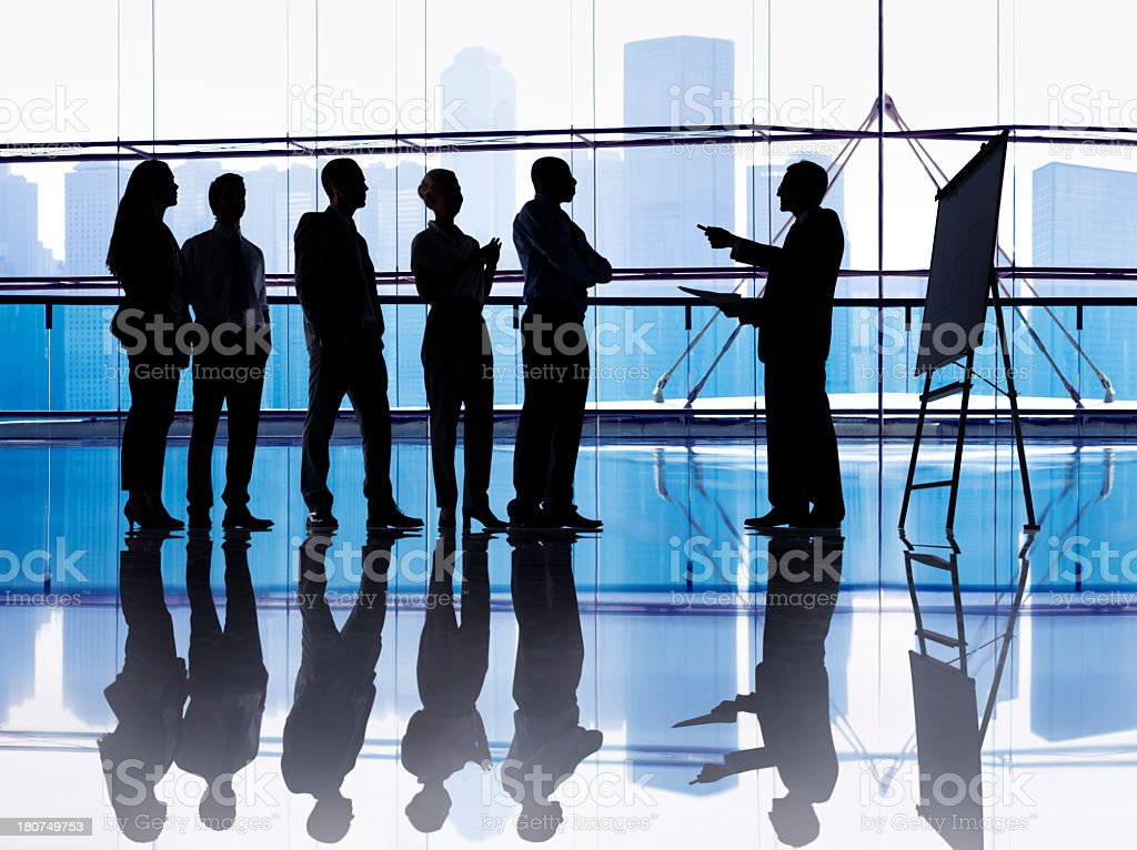 Silhouetted group of business people royalty-free stock photo