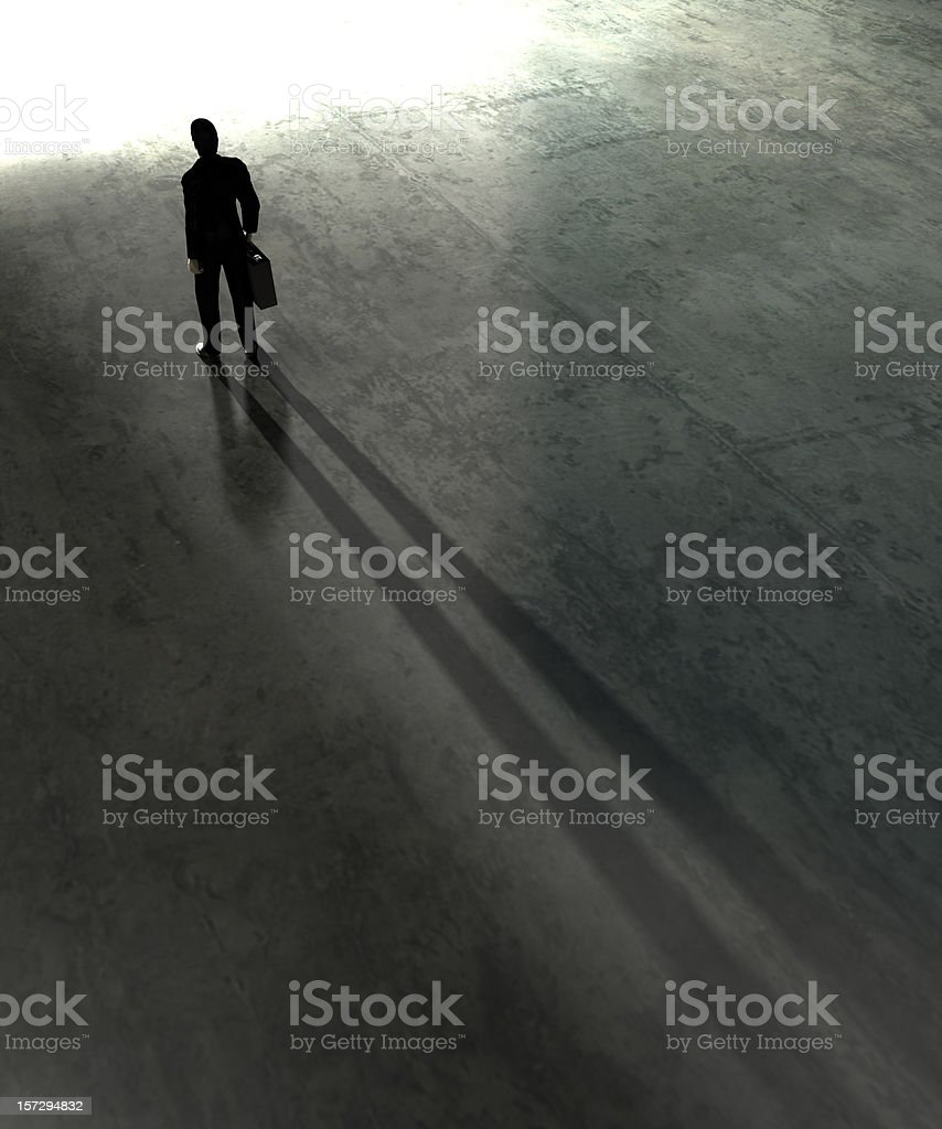 Silhouetted image of man facing toward a bright future stock photo