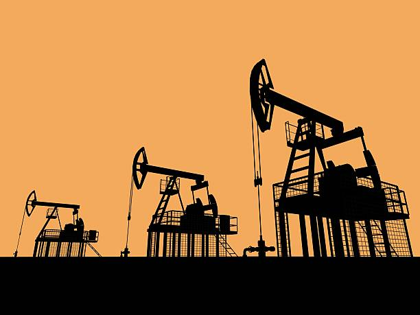 Silhouetted oil wells An illustrated view of three oil well pumps silhouetted against a golden sunset sky. rigging stock pictures, royalty-free photos & images