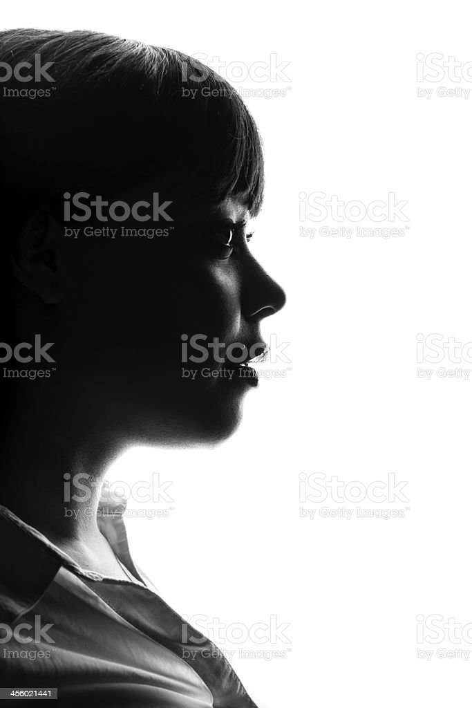 A silhouetted profile of a woman stock photo