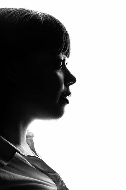 a silhouetted profile of a woman - high contrast stock pictures, royalty-free photos & images