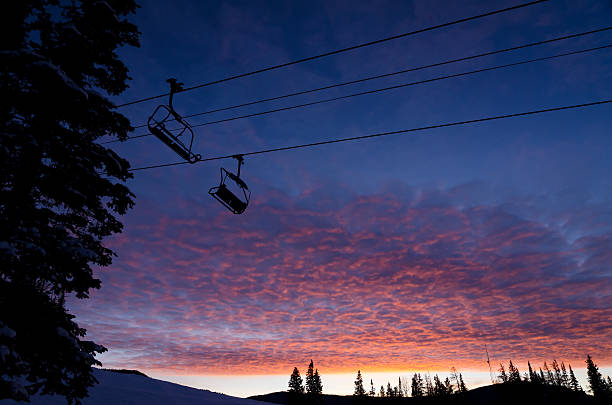 Silhouetted Ski Chair Lifts Against Pink Sunset Sky Silhouetted Ski Chair Lifts Against Pink Sunset Sky.  Dramatic sky and clouds with silhouetted chairlifts.  Captured as a 14-bit Raw file. Edited in ProPhoto RGB color space. beaver creek colorado stock pictures, royalty-free photos & images