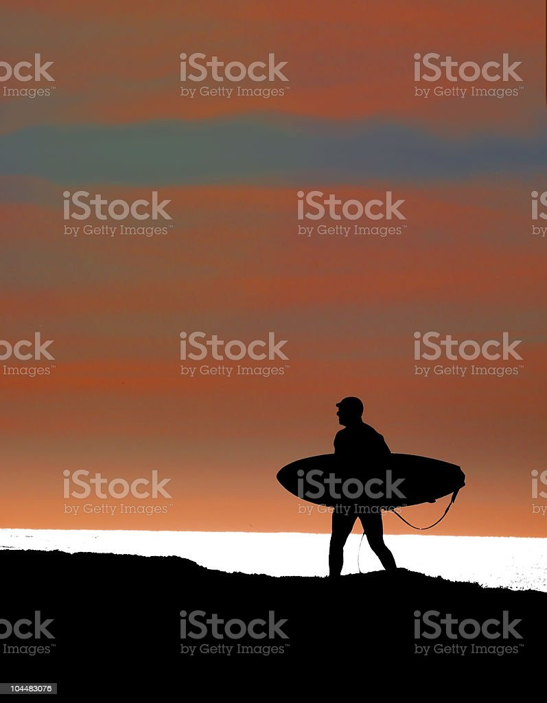 Silhouetted surfer stock photo