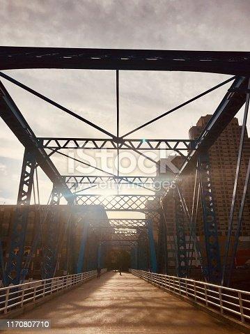 Blue bridge in Grand Rapids Michigan in morning light silhouette
