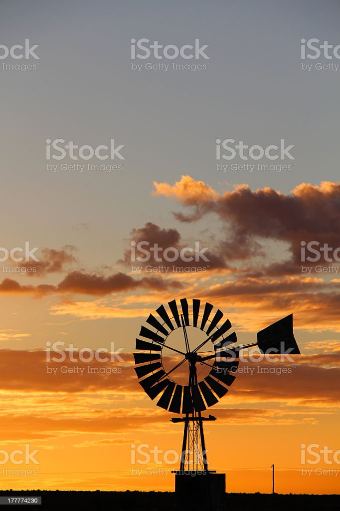 Silhouetted windmill royalty-free stock photo