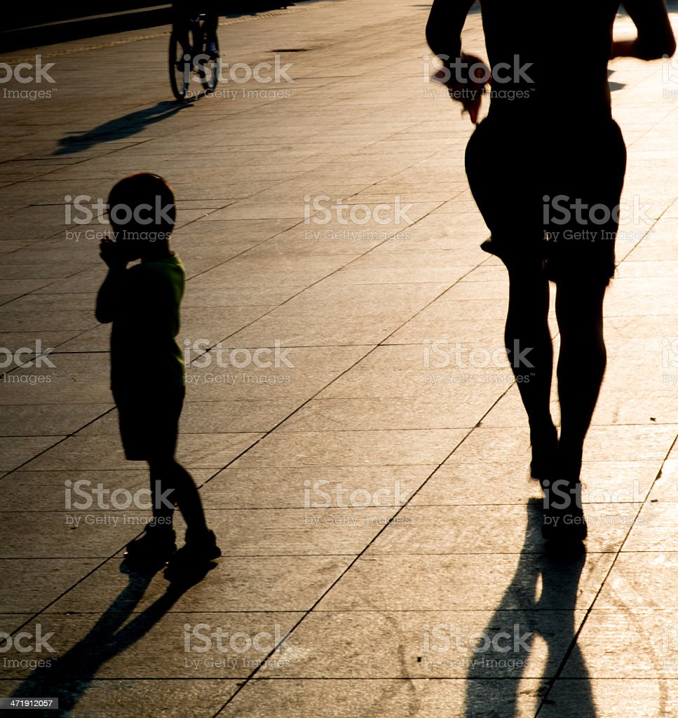silhouettes and shadows of people walking royalty-free stock photo