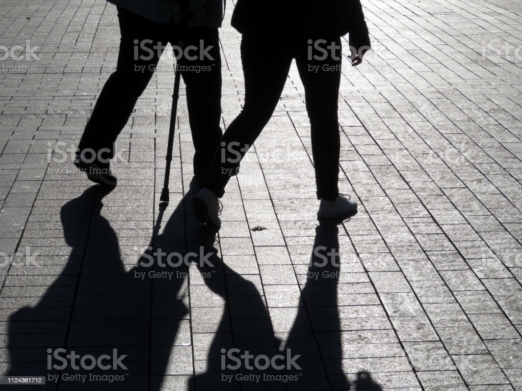Couple outdoors, man with cane, concept of limping person, blind,...