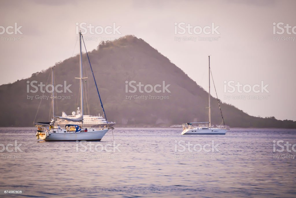 Silhouettes at Sunset in Dominica stock photo