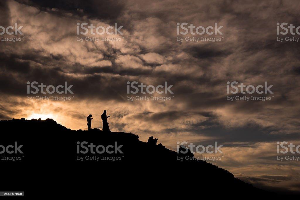 Silhouettes during sunset on the slopes of Tolbachik Volcano Стоковые фото Стоковая фотография