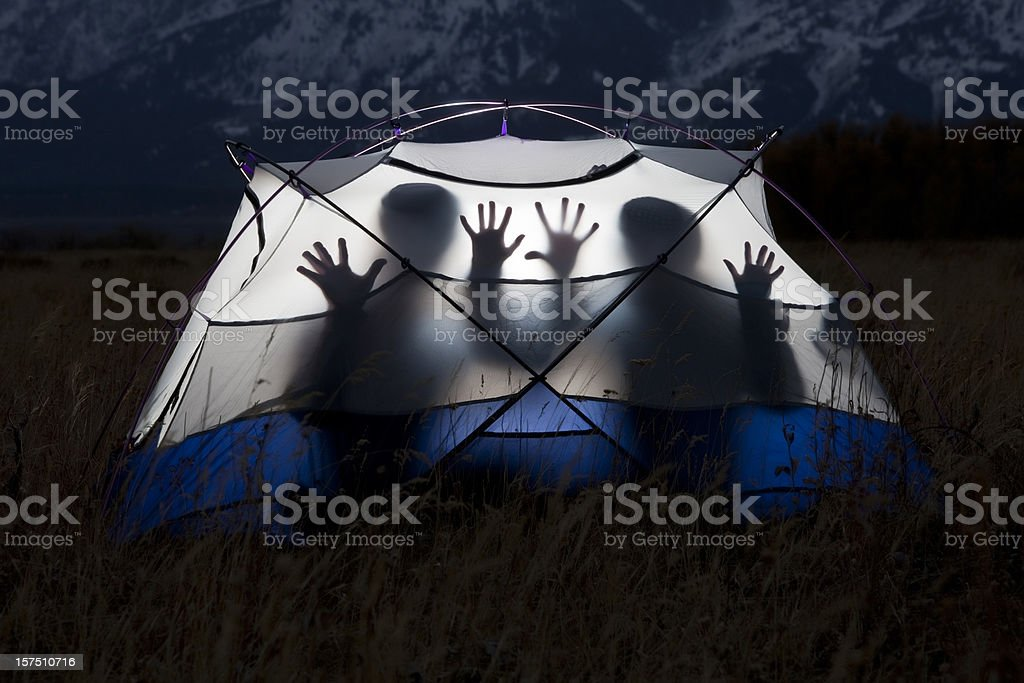 Silhouettes in a tent royalty-free stock photo