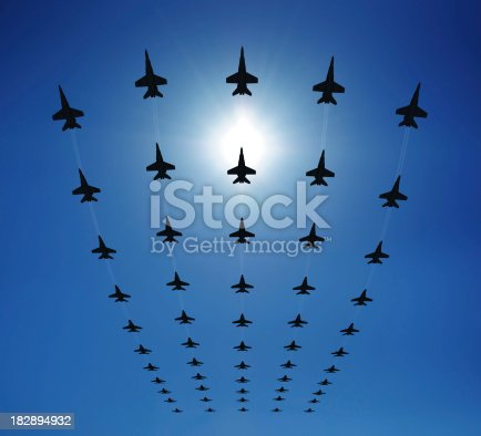 Rows of fighter jets flying in the sky. Clear sunny day. Check out some other airplane files: