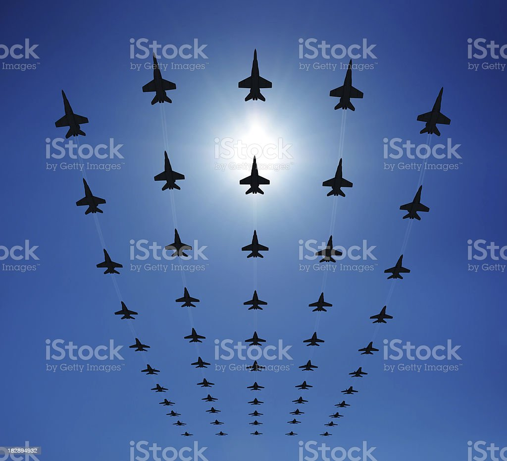 F18 silhouettes in the sky stock photo
