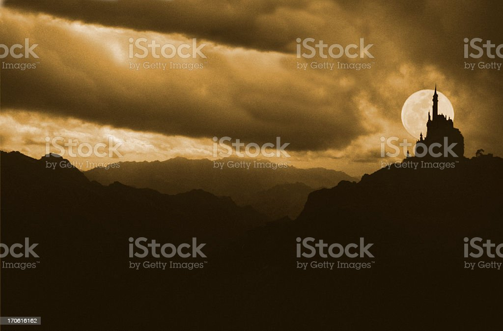 Silhouettes of a castle with full moon background behind it stock photo