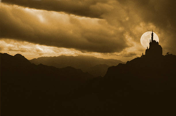 silhouettes of a castle with full moon background behind it - romantic moon stock photos and pictures