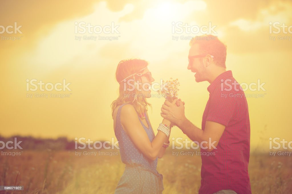 Silhouettes of a couple enjoying outdoors. royalty-free stock photo