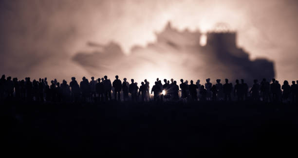 silhouettes of a crowd standing at blurred military war ship on foggy background. selective focus. passengers try to escape. - protestor stock pictures, royalty-free photos & images