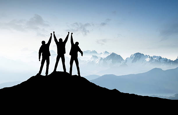 silhouettes of a team - endurance stock pictures, royalty-free photos & images