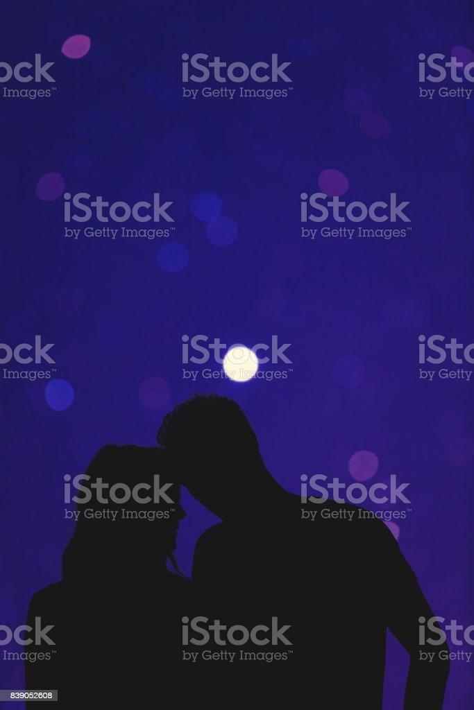 Silhouettes of a young couple under the de-focused starry sky. My astronomy work. stock photo