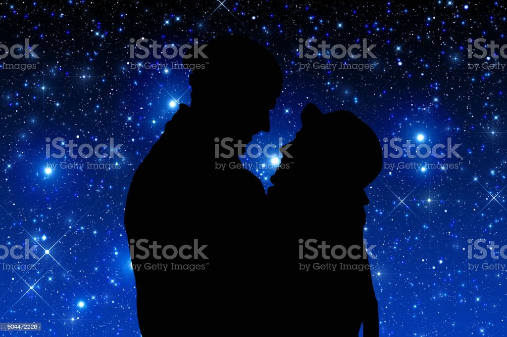 Silhouettes of a young couple under the starry sky. Elements of this image are my work. stock photo