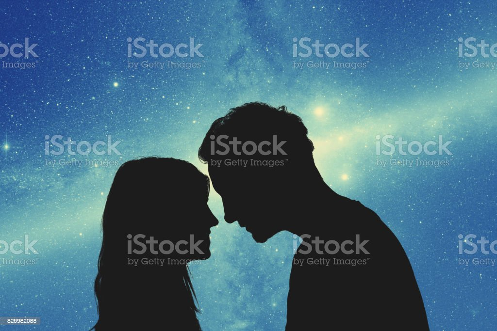 Silhouettes of a young couple under the starry sky. My astronomy work. stock photo