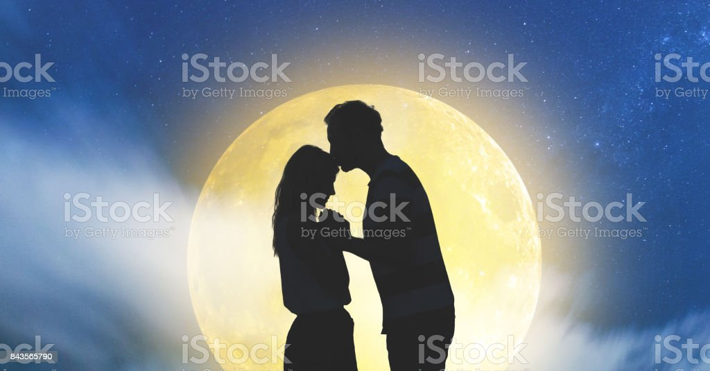 Silhouettes of a young couple under the starry sky with full Moon. My astronomy work. stock photo