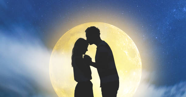silhouettes of a young couple under the starry sky with full moon. my astronomy work. - romantic moon stock photos and pictures