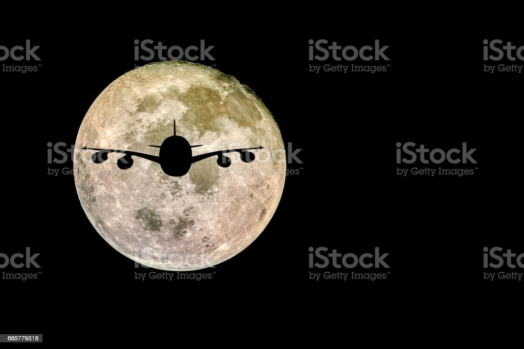 Silhouettes of Aircraft and super moon, Full moon 'Elements of this image furnished by NASA' royalty-free stock photo