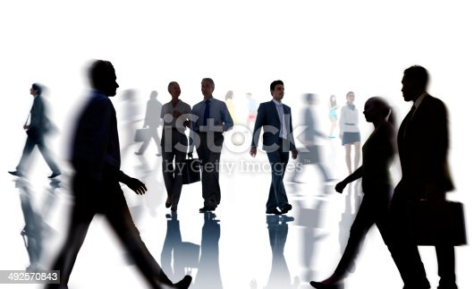 istock Silhouettes of Business and Casual People Walking 492570843
