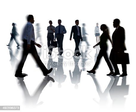 istock Silhouettes of Business and Casual People Walking 492596373