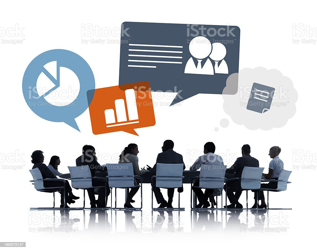 Silhouettes of Business People Discussing Business Issues stock photo