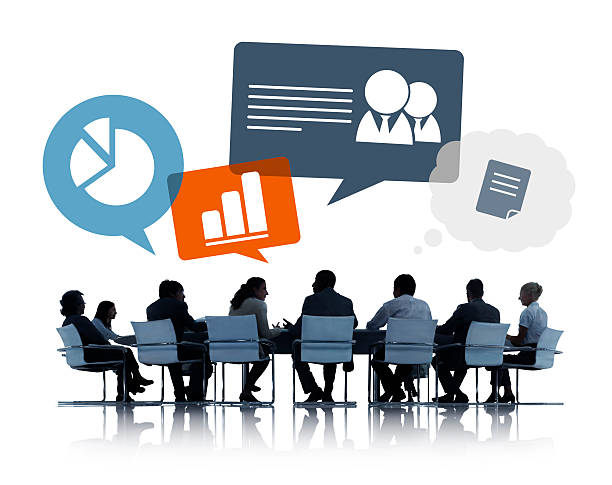 Silhouettes of Business People Discussing Business Issues Silhouettes of Business People Discussing Business Issues governing board stock pictures, royalty-free photos & images