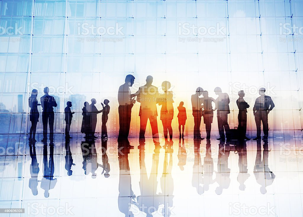 Silhouettes of Business People Discussing Outdoors stock photo