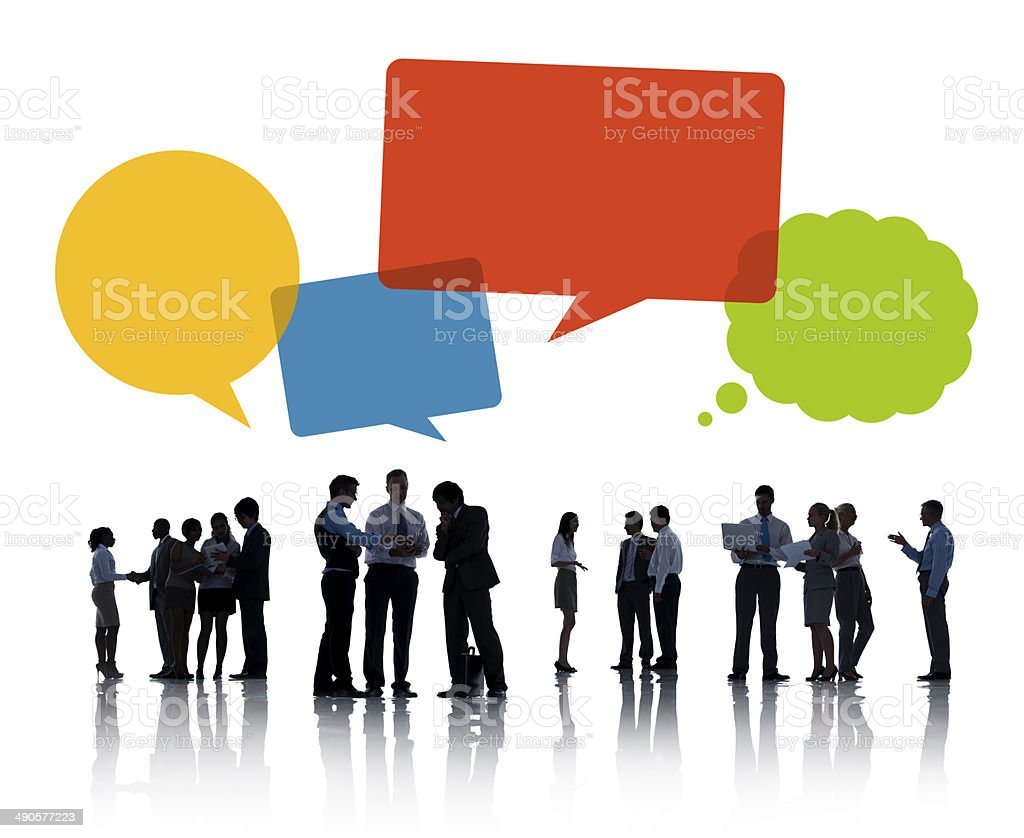 Silhouettes of Business People Discussing with Speech bubble stock photo