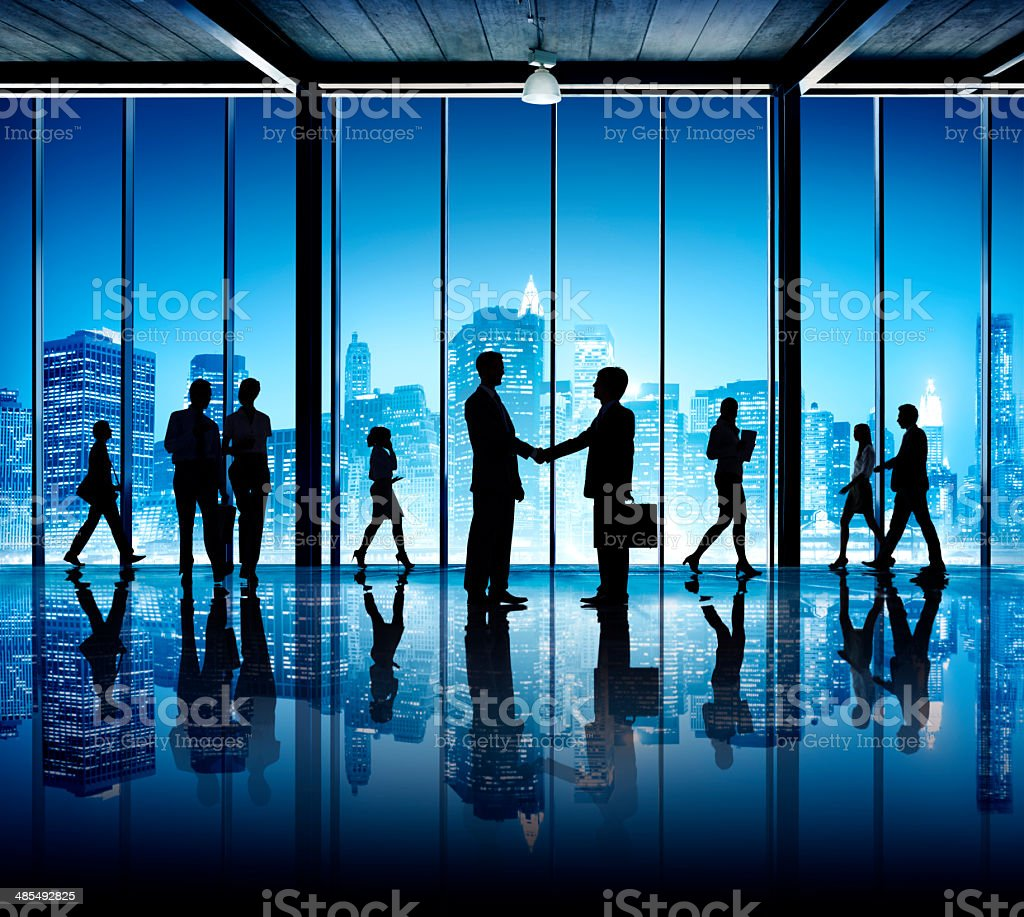 Silhouettes of business people in office building royalty-free stock photo