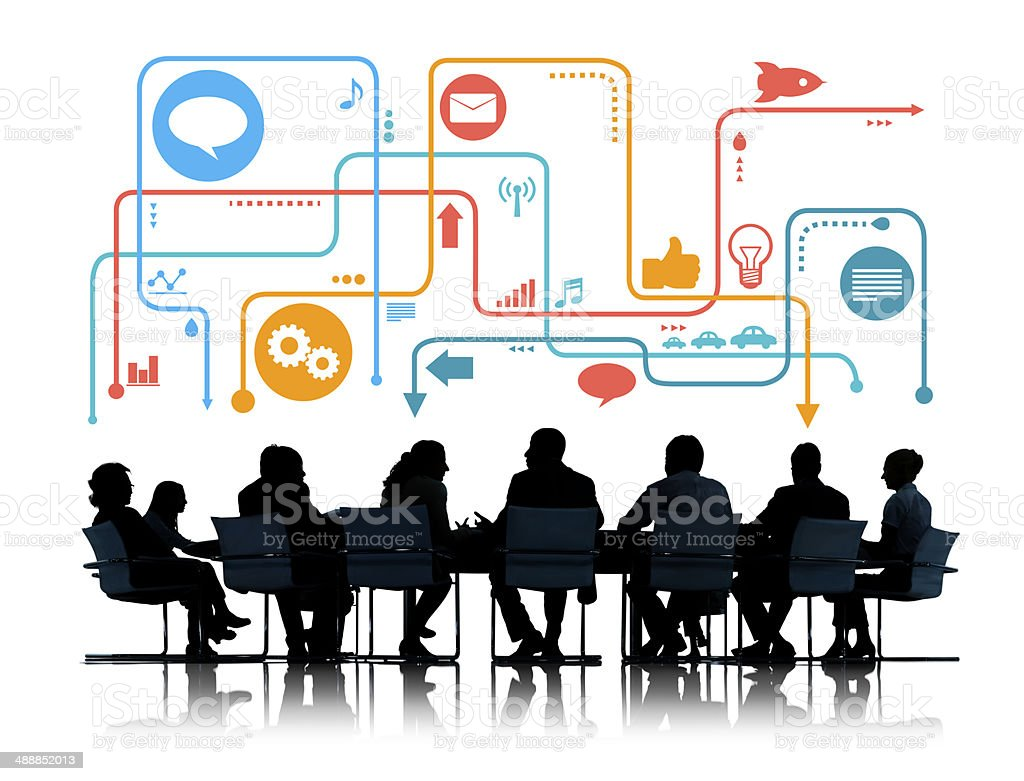 Silhouettes of Business People Meeting with Social Media Symbols stock photo