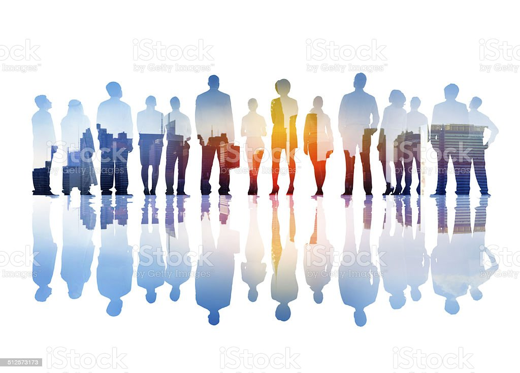 Silhouettes of Business People Overlaid with Cityscape stock photo