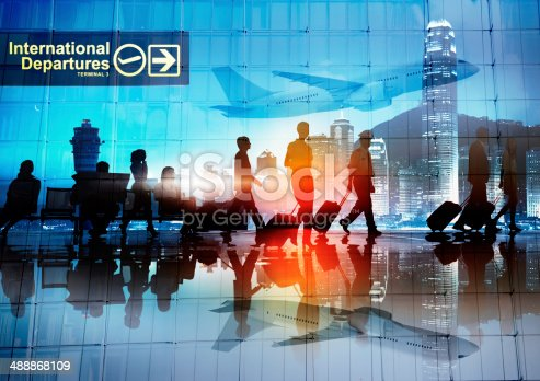 istock Silhouettes of Business People Walking in an Airport 488868109