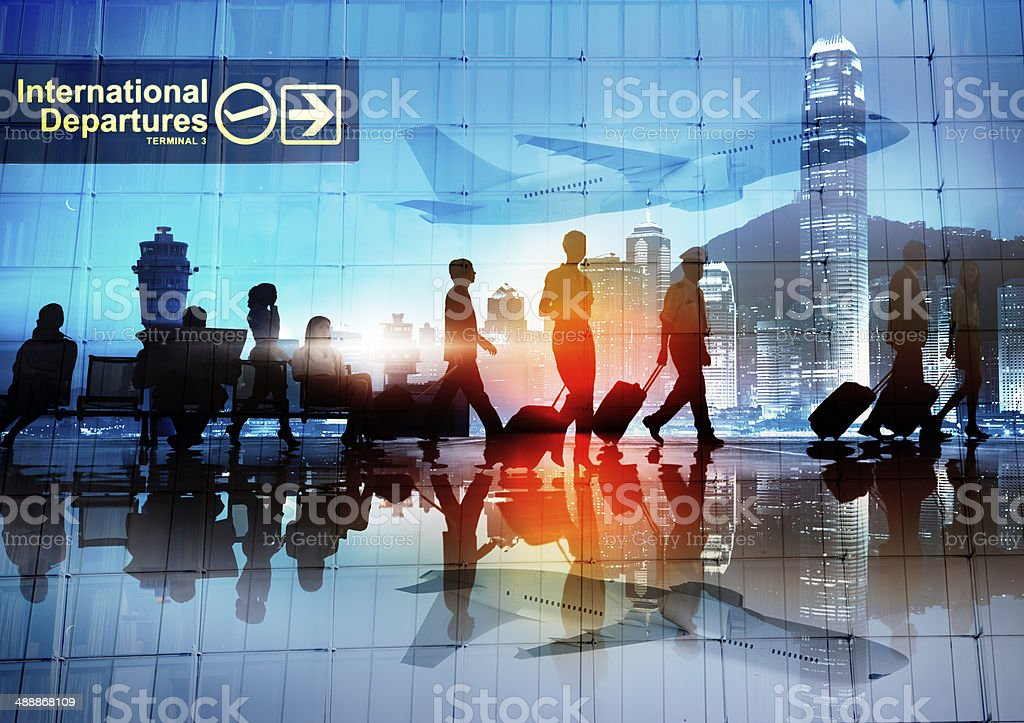 Silhouettes of Business People Walking in an Airport stock photo